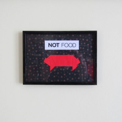 "Red origami pig mixed-media print with ""Not Food"" phrase"