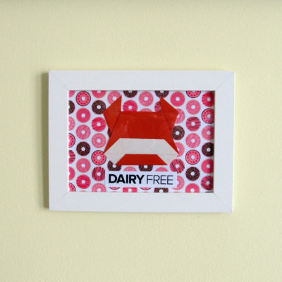"Red Cow with ""Dairy Free"" phrase on donut background."